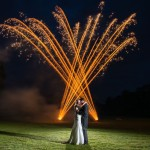 crackling-gold-fireworks-behind-bride-and-groom